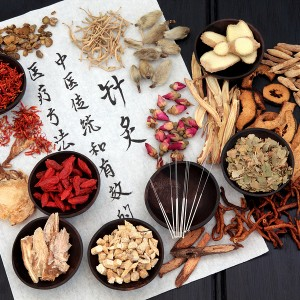 Chinese herbal medicine with acupuncture needles - Toronto Acupuncture Clinic